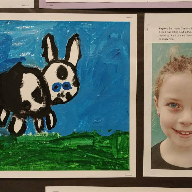 Peyton with her painting of our class pet, Carl.